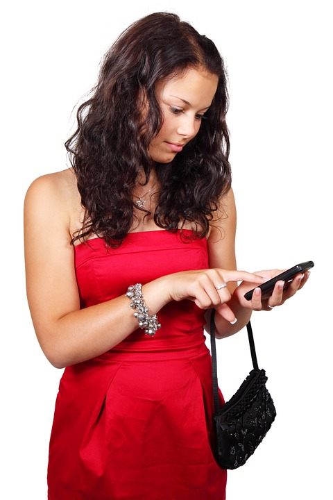 girl in red using a cellphone